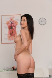Sexy Nurse Nikky Perry Strips And Poses Naked