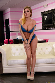 Busty Blondie Britney Amber Undressing On A Couch