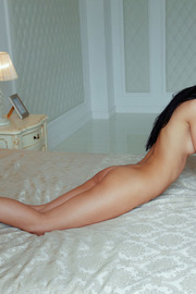 Raven Haired Beauty Kenya Spreading On A Bed