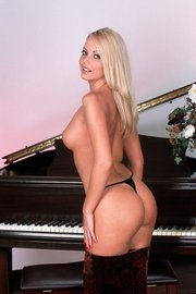 Sexy Jana Cova Posing In Front Of The Piano