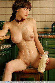 Jade Plays With Milk In The Kitchen