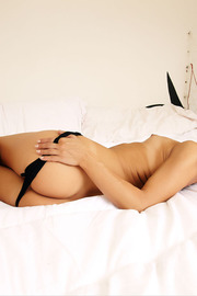Sexy Suzie Carina?s beautiful brown eyes sparkle with a sensuality