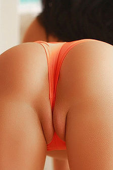 Catie Minx In Orange Booty Shorts