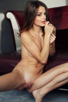 Loretta Poses Naked On The Couch